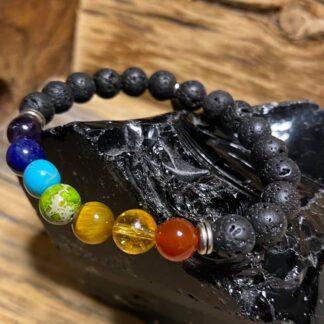 chakra bracelet on lava